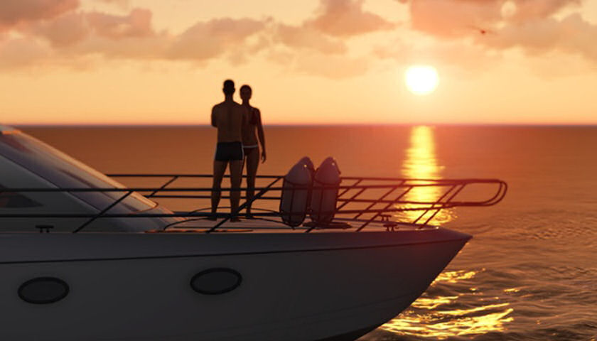 couple on yacht at sunset